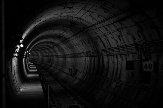 canva-long-round-dark-tunnel-MACNSy-L0dI